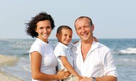 Glückliche Familie mit Kindern eins Stockbilder