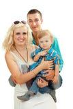Glückliche Familie mit Schätzchen Lizenzfreie Stockfotos