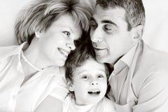 Glückliche Familie - Vater, Mutter und Sohn Stockfotografie