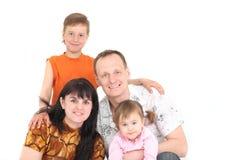 Glückliche Familie von Vierpersonen lizenzfreie stockbilder