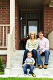 Glückliche Familie zu Hause Stockbild
