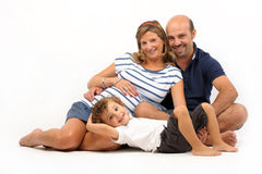 Glückliche Familie zusammen mit schwangerer Frau Lizenzfreies Stockfoto