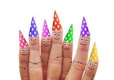 Glückliche Finger in den mehrfarbigen Kappen auf einem weißen Hintergrund Stockbilder