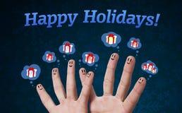 Glückliche Fingersmiley mit Feiertagszeichen Stockfoto
