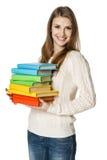 Glückliche Frau, die Bücher anhält Lizenzfreie Stockbilder