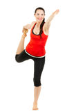Glückliche Frau, die eine Yogaausdehnung tut Stockfotografie