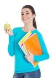 Glückliche Frau, die einen Apfel und Notizbücher hält Lizenzfreies Stockbild