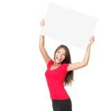 Glückliche Frau, die Zeichen zeigt Stockfotografie