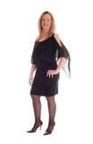 Glückliche Frau im schwarzen Kleid Stockbild