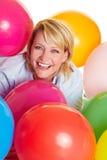 Glückliche Frau mit Ballonen Stockbild