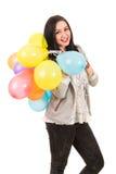 Glückliche Frau mit Ballonen auf ihrer Schulter Stockfotos