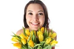 Glückliche Frau mit Blumen Lizenzfreies Stockbild