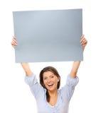 Glückliche Frau mit einer Fahne lizenzfreie stockbilder