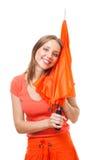Glückliche Frau mit Regenschirm Stockbild