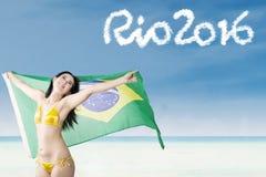 Glückliche Frau mit Text von Rio 2016 Stockfoto