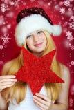 Glückliche Frau am Weihnachten Stockfotos