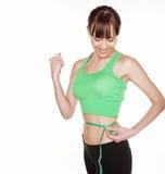 Glückliche Frauen-messende Taille Lizenzfreies Stockfoto