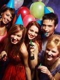 Glückliche Freunde auf einer Party Stockfotografie