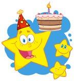 Glückliche gelbe Sterne mit einem Geburtstagkuchen über Blau Stockfoto