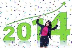 Glückliche Geschäftsfrau, die ein neues Jahr feiert Stockfotos