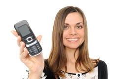 glückliche Geschäftsfrau, die ihr neues Telefon zeigt Stockbild