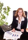 Glückliche Geschäftsfrau im Büro Stockfoto
