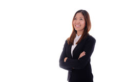 Glückliche Geschäftsfrau ist, denkend lächelnd und auf weißem Hintergrund Lizenzfreies Stockfoto
