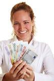 Glückliche Geschäftsfrau mit Euro lizenzfreie stockbilder