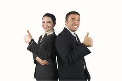 Glückliche Geschäftsleute mit Thumb-up Stockfoto