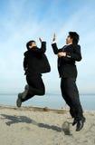 Glückliche Geschäftsmänner Stockfotografie