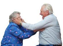 Glückliche Großeltern spielen den Dummkopf Stockbild