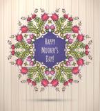 Glückliche Grußkarte des Mutter Tages Blumenkranz-Holz-Hintergrund Stockfoto
