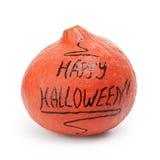 Glückliche Halloween-Aufschrift auf dem Kürbis Stockbilder