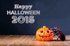 Glückliche Halloween-Mitteilung 2015 mit Kürbis und Spinne Lizenzfreie Stockfotos