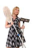 Glückliche Hausfrau mit Besen Stockfoto