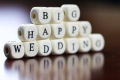 Glückliche Hochzeit des Textwürfels Stockbilder