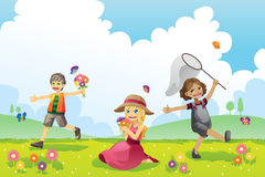 Glückliche Jahreszeit der Kinder im Frühjahr Lizenzfreies Stockbild