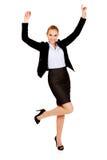 Glückliche junge blonde Geschäftsfrau Stockfoto