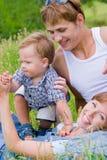 Glückliche junge Familie Stockfotos