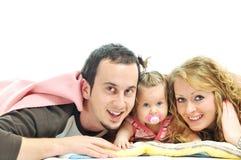 Glückliche junge Familie Lizenzfreie Stockfotografie