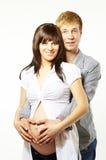 Glückliche junge Familie in der Liebe, schwanger Stockfoto