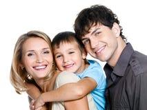 Glückliche junge Familie mit Sohn Stockbild