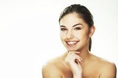 Glückliche junge Frau auf weißem Hintergrund Stockbild