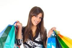 Glückliche junge Frau mit Einkaufenbeuteln Lizenzfreies Stockfoto
