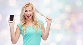 Glückliche junge Frau oder Jugendliche mit Smartphone Stockfoto