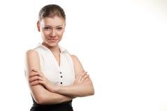 Glückliche junge Geschäftsfrau mit der gefalteten Hand lizenzfreie stockfotografie