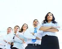 Glückliche junge Geschäftsfrau mit ihrem Team Lizenzfreie Stockfotografie