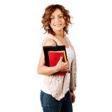 Glückliche junge Kursteilnehmermädchen-Holdingbücher Stockbilder