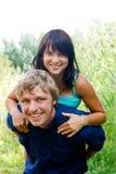 Glückliche junge Paare Stockfotografie