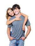 Glückliche junge Paare, die Kamera betrachten stockbilder